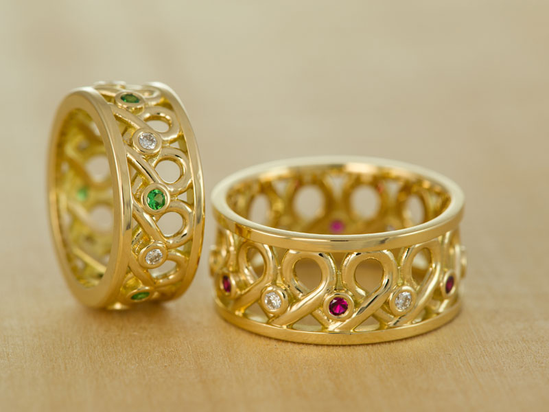 18ct yellow gold wedding bands with diamonds, tsavorites, and rubies